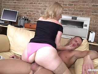 Dominant mature woman fucks her neighbor's semi-conscious stepson at her place