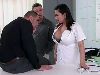 Busty brunette doctor Tigerr Benson fucked by two wide-ranging dicks