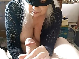 Nasty mature wife with a mask sucks a large detect alongside POV video