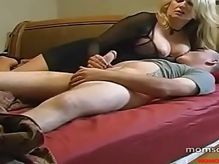 Luscious mommy makes her son cum before sleep!