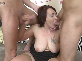 Naughty mature Progenitrix fucking two boys readily obtainable once