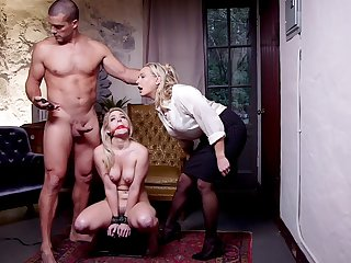 Submissive blonde back fucked in a brutal BDSM threesome