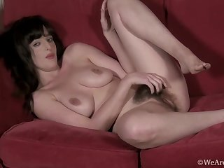 Kate Anne is wearing sexy, black lingerie and stockings and getting accessible to play with herself