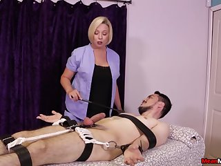 Strict blonde masseuse gives a Femdom handjob to a gambol client