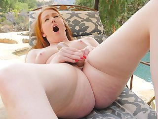 Close up video of Sonia playing with her pink taco in outdoors